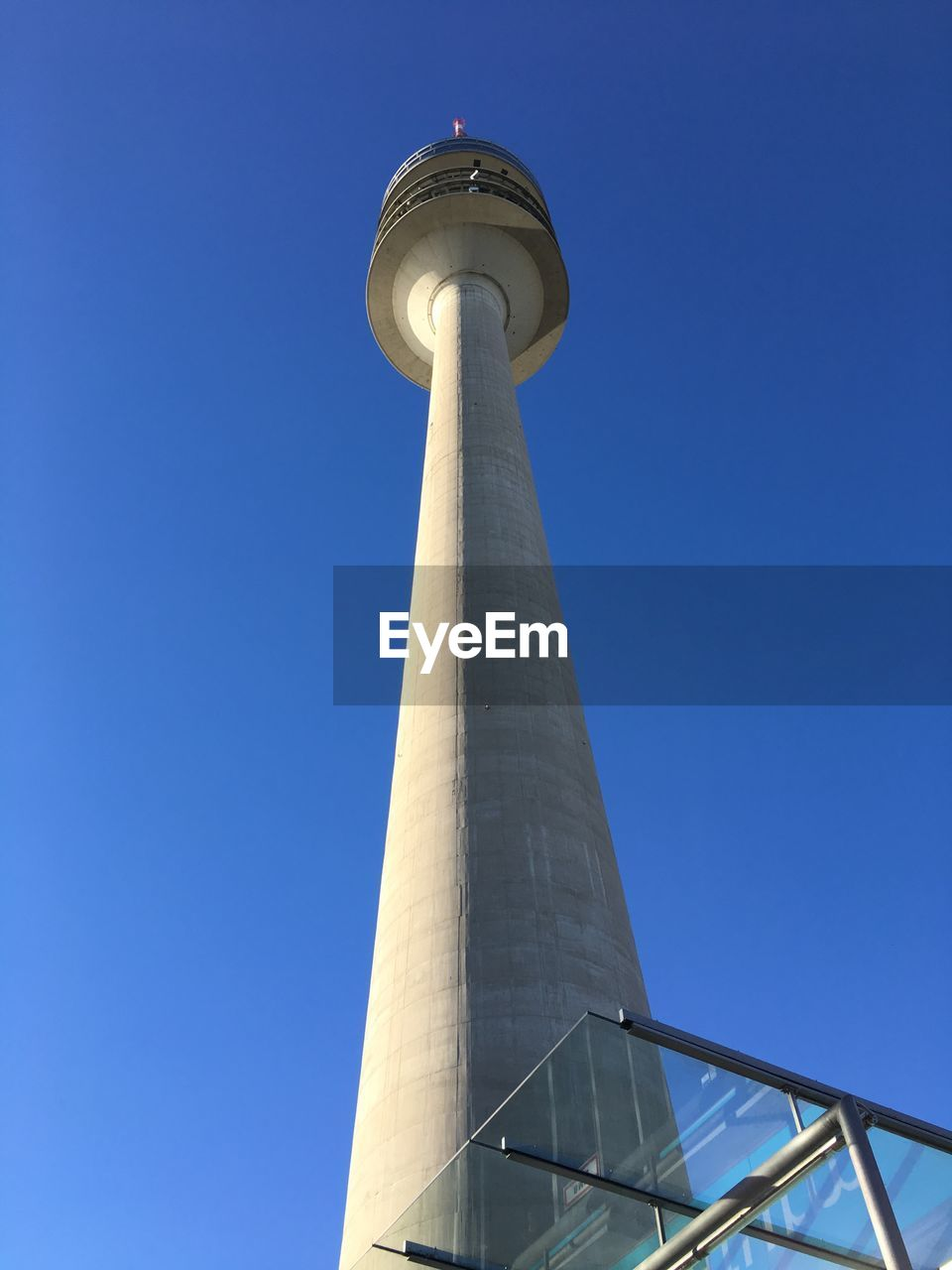 architecture, low angle view, built structure, sky, building exterior, blue, tall - high, clear sky, tower, nature, day, no people, travel destinations, city, travel, outdoors, tourism, copy space, building, sunlight, global communications