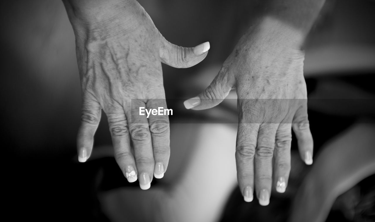 human hand, hand, human body part, finger, human finger, body part, two people, real people, adult, togetherness, bonding, people, indoors, women, focus on foreground, selective focus, close-up, men, positive emotion, holding hands, care