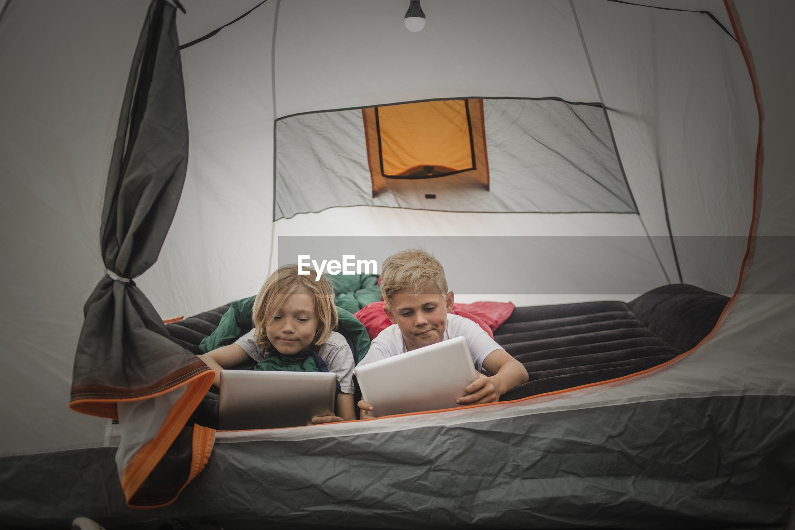 PEOPLE USING LAPTOP ON BED