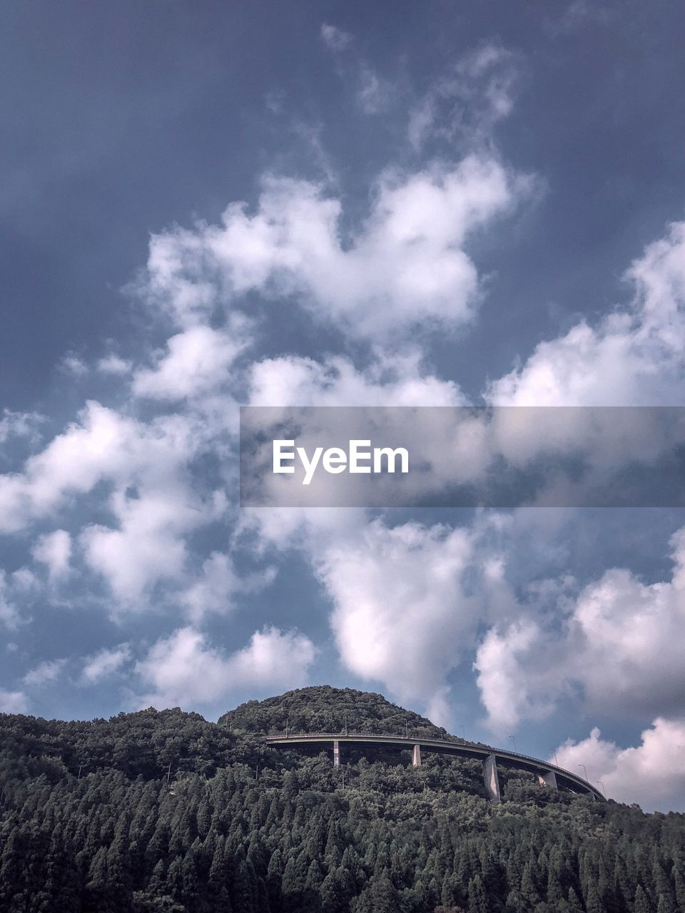 sky, cloud - sky, beauty in nature, mountain, scenics - nature, low angle view, tranquil scene, tranquility, nature, non-urban scene, day, environment, no people, landscape, land, rock, physical geography, outdoors, plant, tree, formation, mountain peak