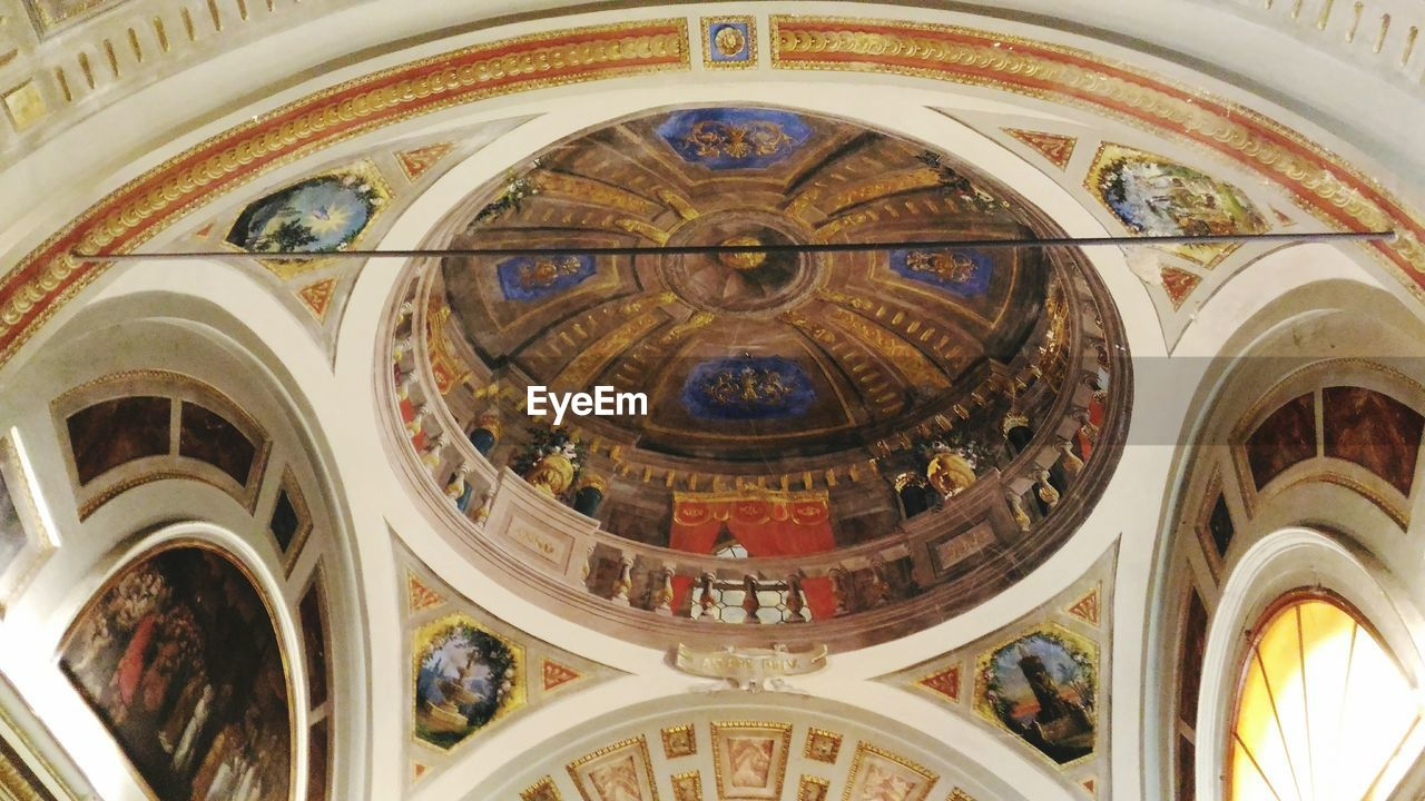 architecture, religion, place of worship, built structure, low angle view, ceiling, indoors, travel destinations, spirituality, history, dome, cupola, no people, day