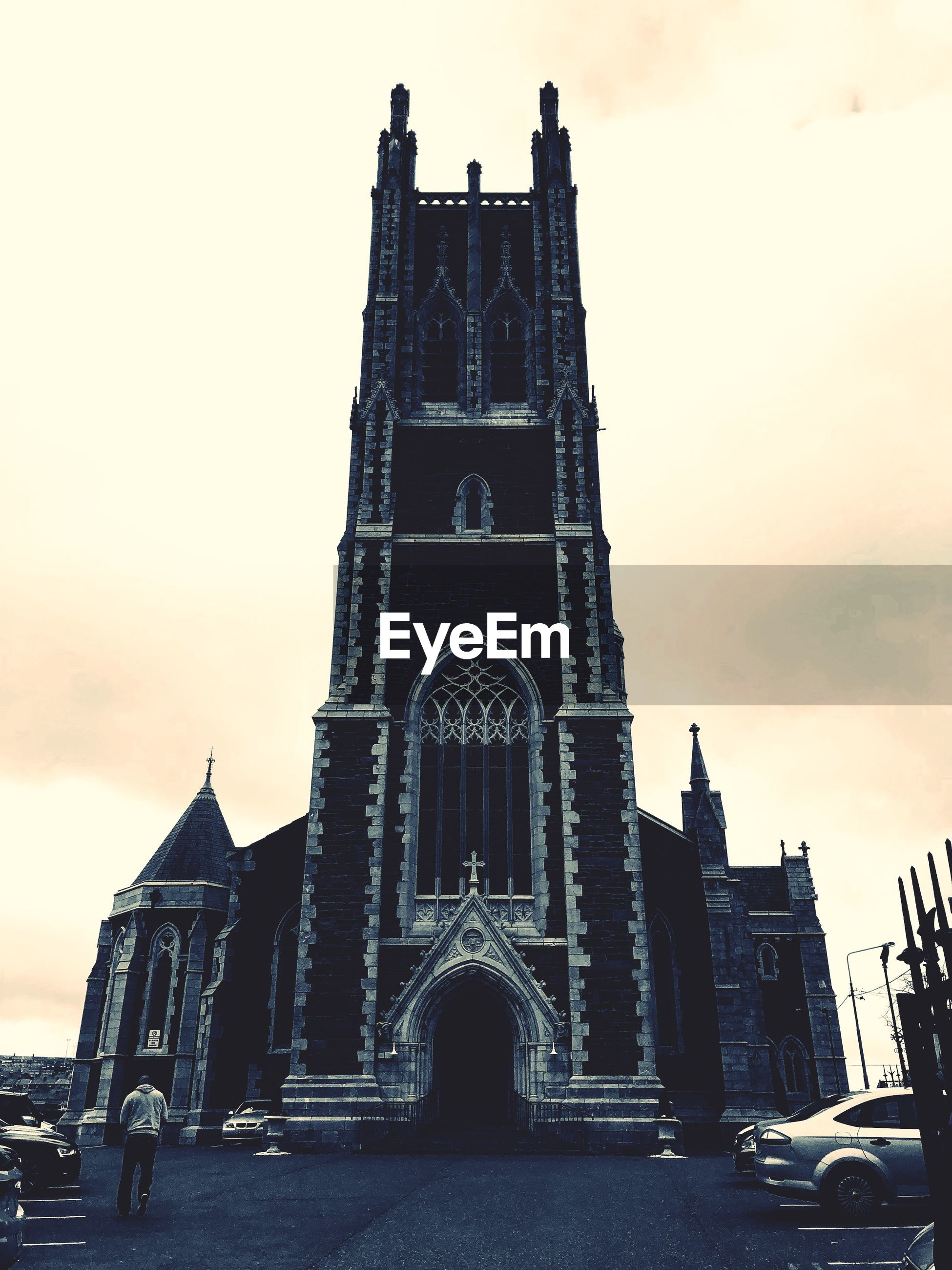 architecture, built structure, sky, building exterior, religion, building, spirituality, place of worship, belief, travel destinations, low angle view, the past, tower, history, nature, city, sunset, no people, gothic style, spire