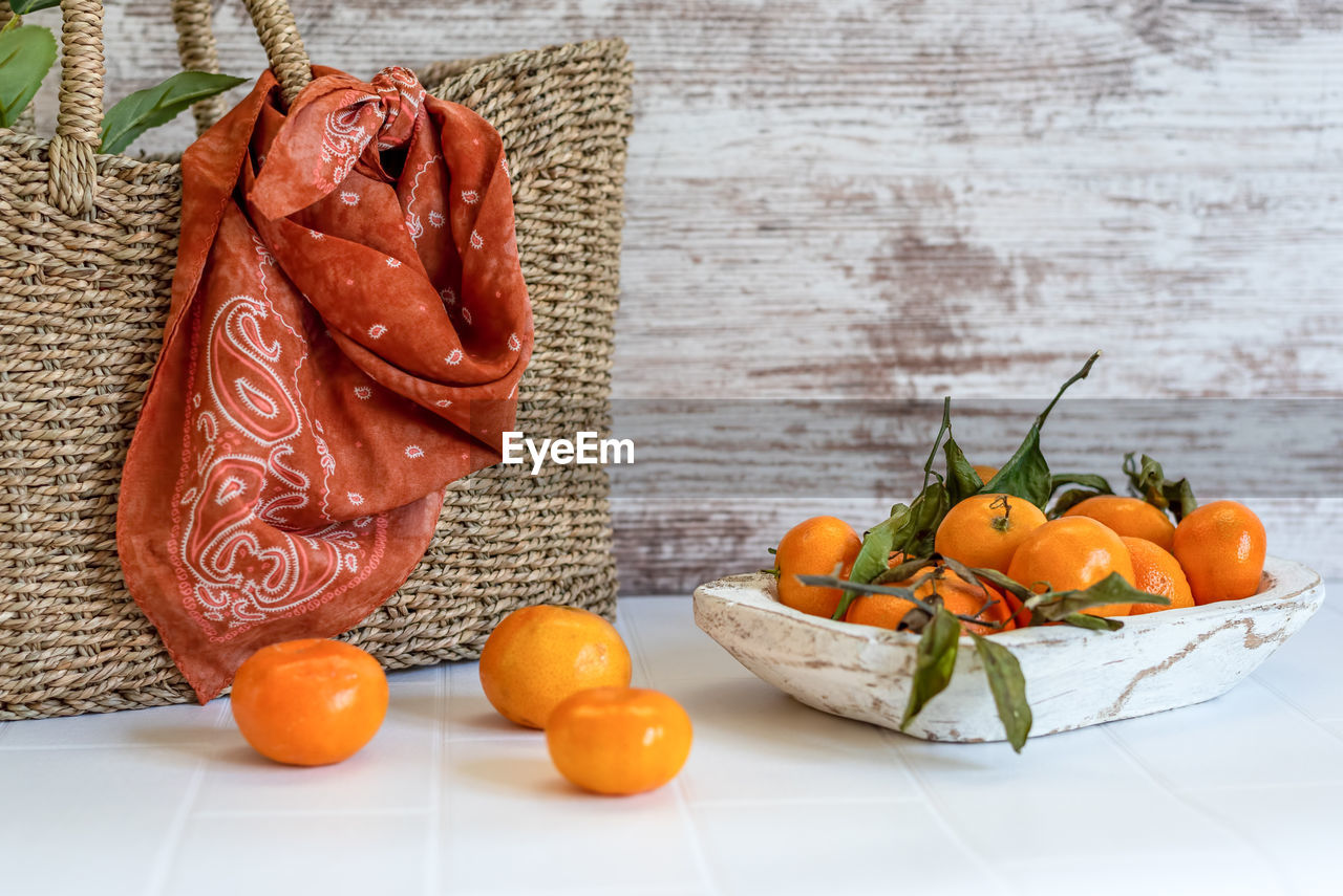 HIGH ANGLE VIEW OF VEGETABLES AND ORANGE ON TABLE