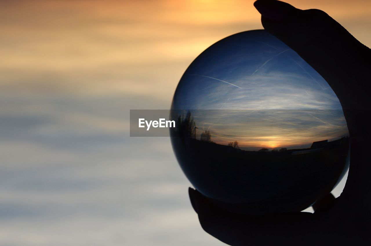 sky, sunset, sphere, nature, cloud - sky, close-up, silhouette, orange color, no people, crystal ball, ball, beauty in nature, transparent, glass - material, reflection, outdoors, focus on foreground, geometric shape, scenics - nature, shape