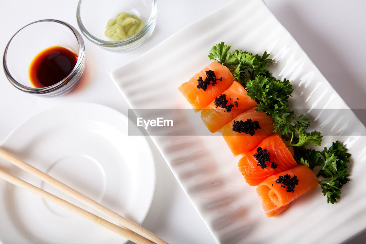 food and drink, food, plate, freshness, healthy eating, table, still life, indoors, ready-to-eat, high angle view, wellbeing, serving size, no people, salmon - seafood, orange color, seafood, slice, japanese food, asian food, sushi, garnish, temptation, tray