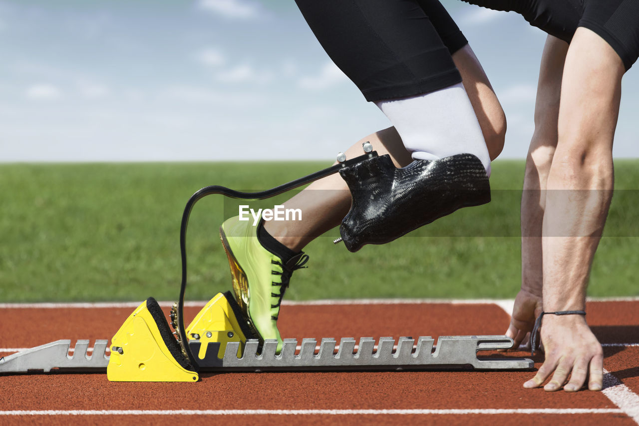 Low Section Of Man On Running Track