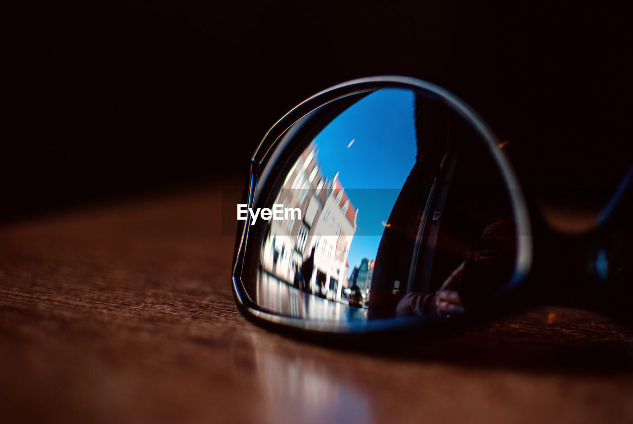 Reflection Of Building On Sunglasses