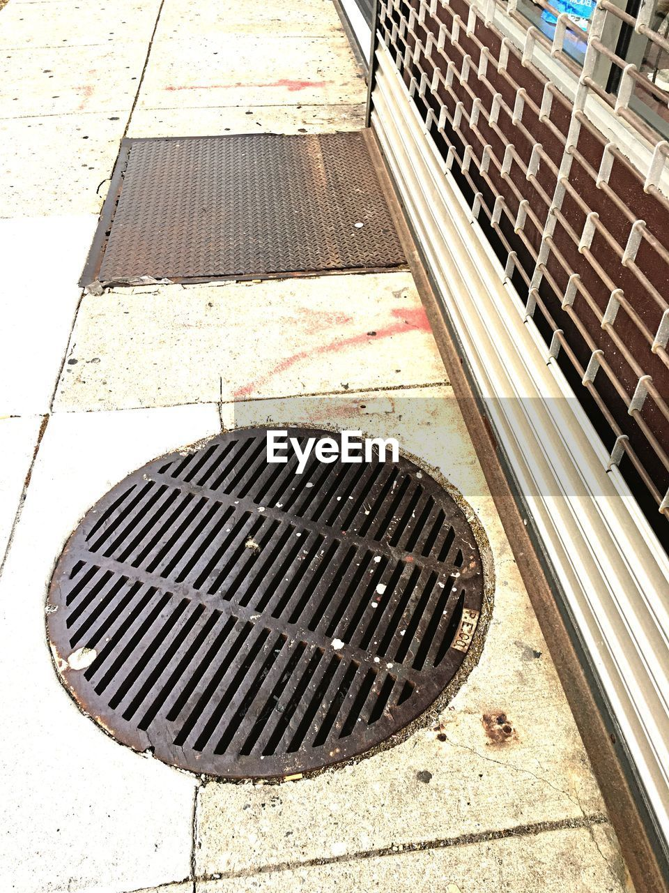 sewer, sewage, manhole, gutter, drain, metal grate, high angle view, air duct, street, no people, day, outdoors, architecture