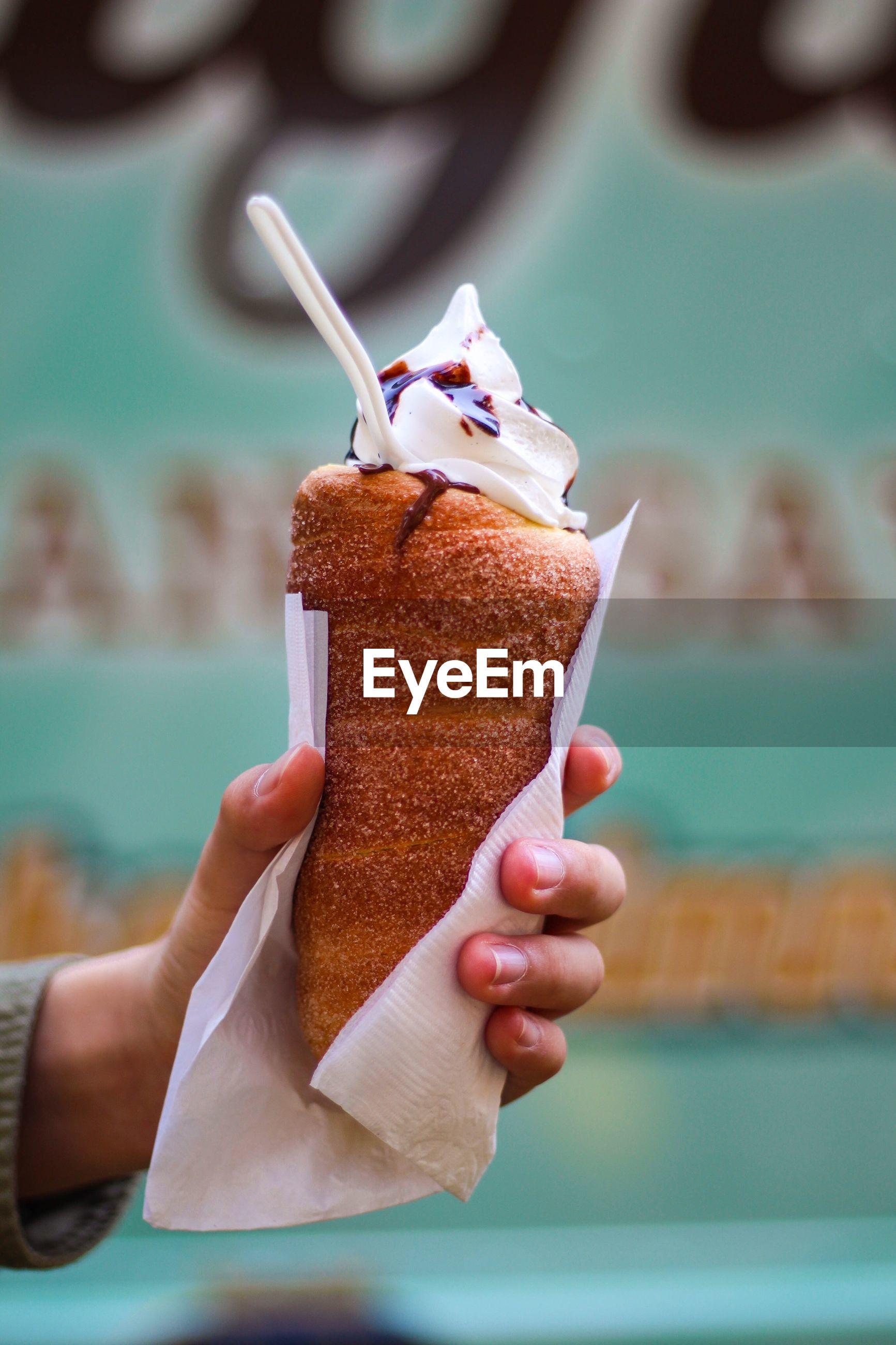 Close-up of hand holding ice cream