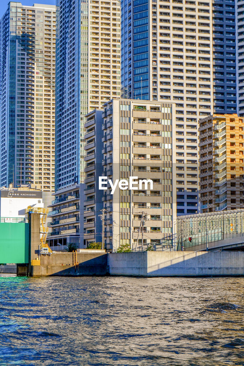 building exterior, architecture, built structure, building, city, office building exterior, water, skyscraper, waterfront, modern, no people, day, office, tall - high, nature, travel destinations, outdoors, river, residential district, cityscape, financial district
