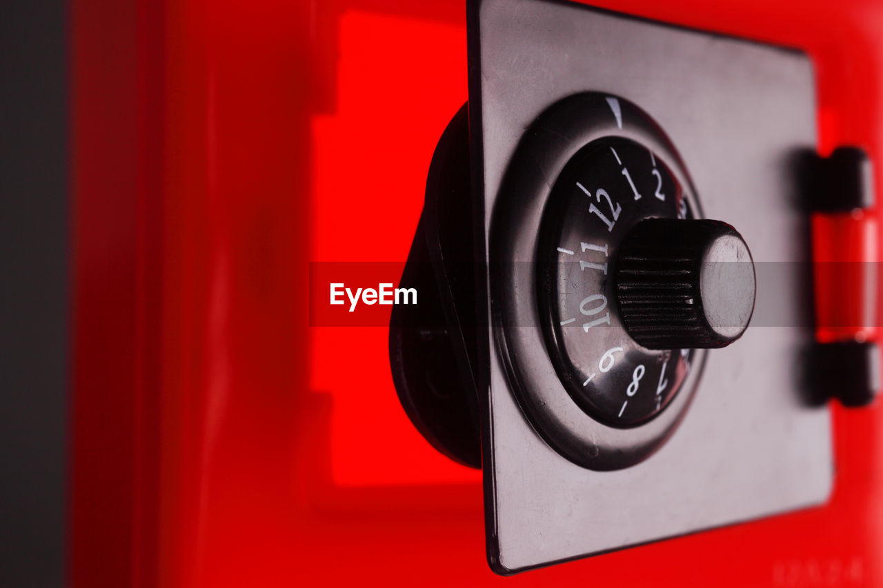 red, technology, close-up, no people, photography themes, black color, camera - photographic equipment, indoors, control, sign, wall - building feature, communication, shape, focus on foreground, fuel and power generation, equipment, white color, circle, geometric shape, arts culture and entertainment, digital camera