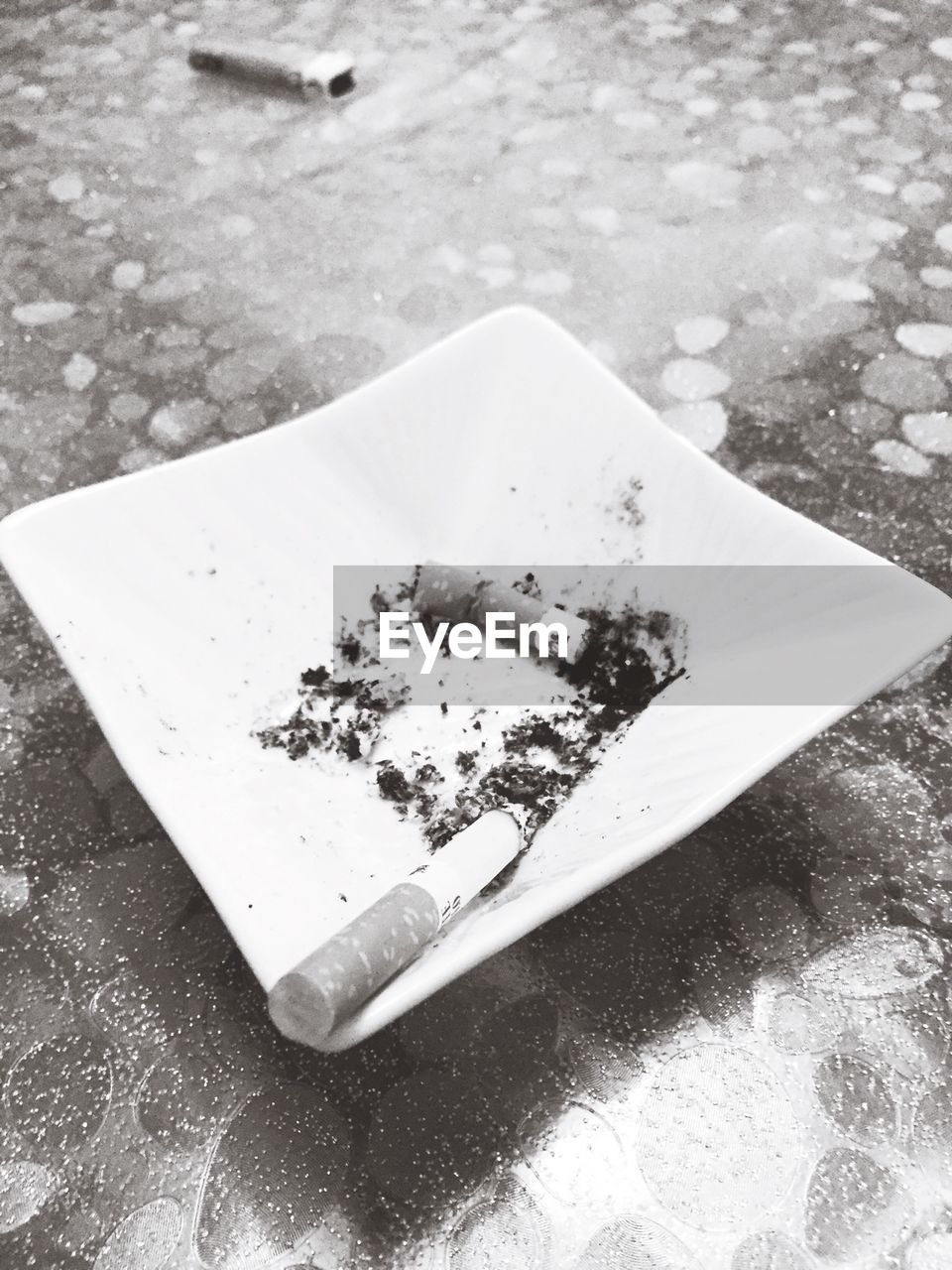 addiction, still life, high angle view, table, bad habit, ashtray, close-up, social issues, cigarette butt, no people, outdoors, day