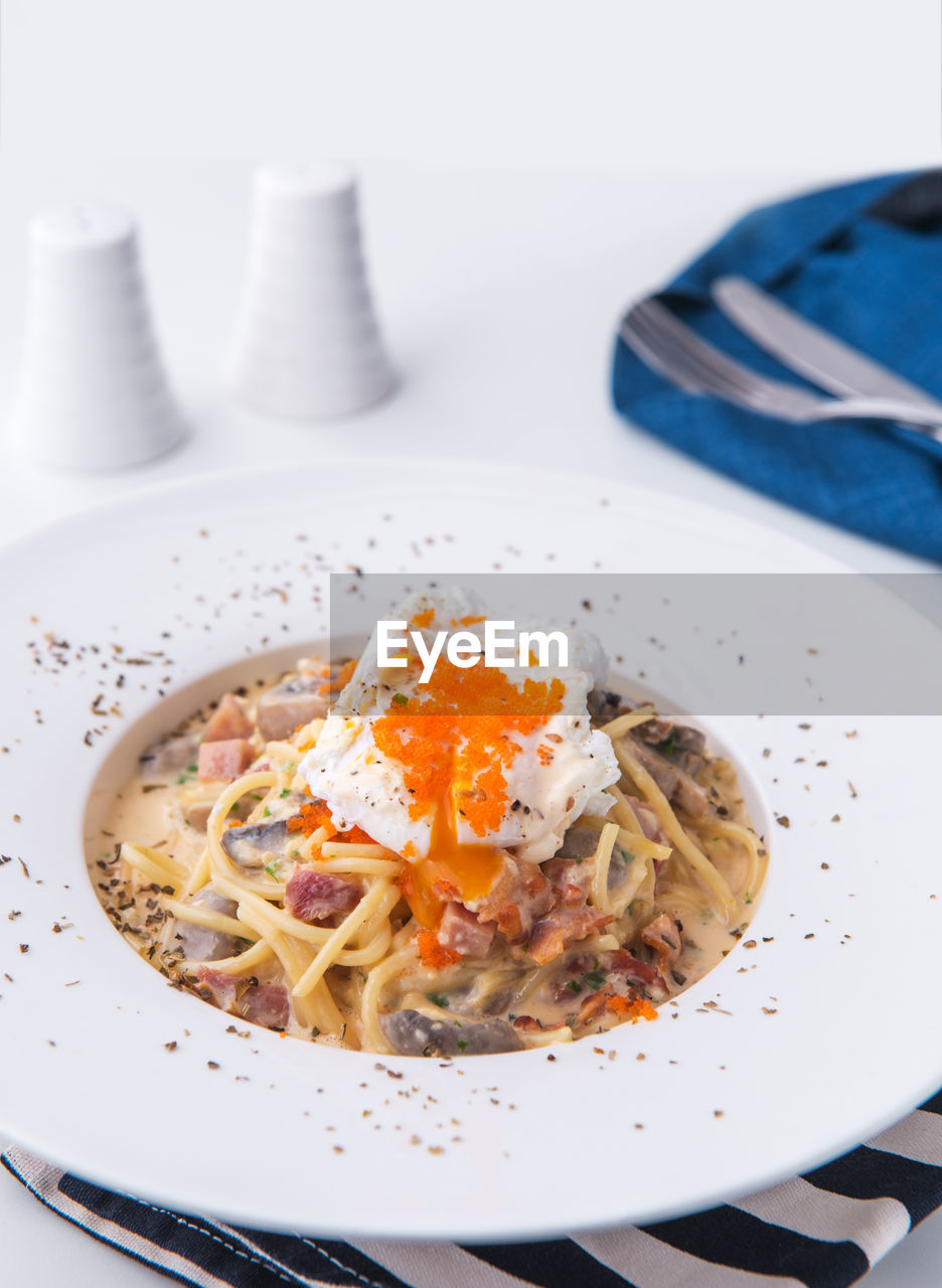food, food and drink, ready-to-eat, plate, freshness, indoors, pasta, still life, healthy eating, wellbeing, serving size, close-up, indulgence, italian food, table, no people, meal, high angle view, spaghetti, bowl, garnish, temptation, crockery