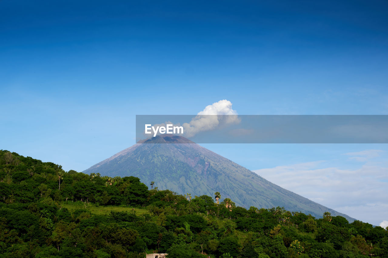 mountain, sky, scenics - nature, volcano, beauty in nature, tranquil scene, non-urban scene, landscape, tranquility, environment, land, idyllic, plant, no people, nature, blue, cloud - sky, geology, day, active volcano, mountain peak, outdoors, volcanic crater, snowcapped mountain
