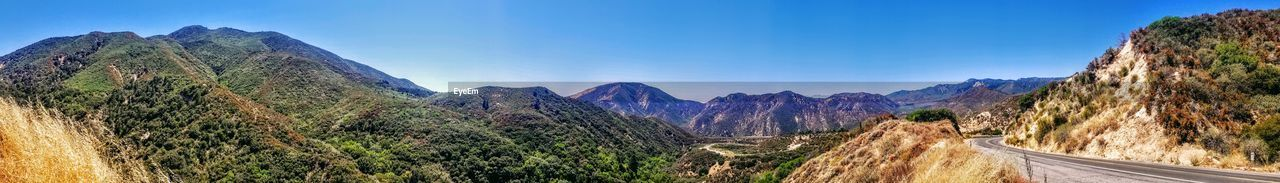 mountain, sky, scenics - nature, panoramic, mountain range, beauty in nature, nature, environment, rock, tranquil scene, landscape, tranquility, no people, transportation, plant, non-urban scene, road, day, the way forward, rock - object, formation, outdoors, mountain peak