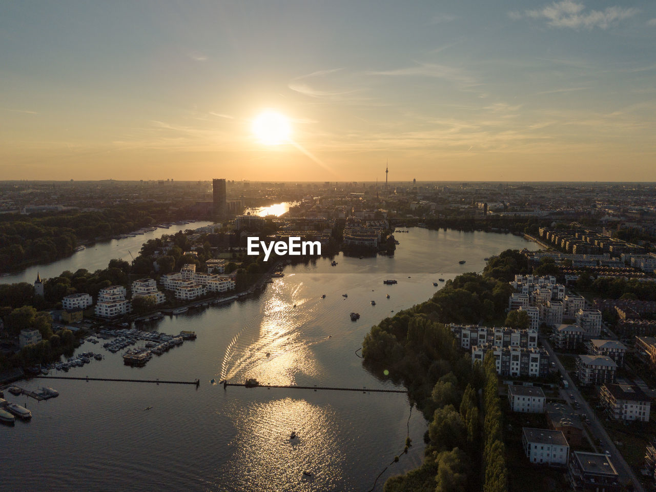 sky, sunset, water, building exterior, architecture, built structure, nature, cityscape, cloud - sky, city, sun, no people, scenics - nature, sunlight, high angle view, river, outdoors, building, travel destinations, skyscraper