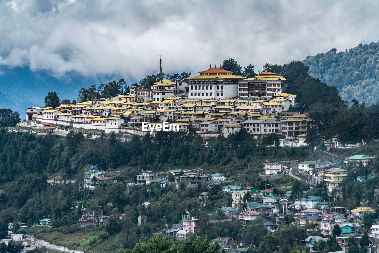 building exterior, architecture, built structure, building, cloud - sky, city, mountain, sky, nature, plant, residential district, religion, place of worship, day, belief, no people, spirituality, tree, cityscape, travel destinations, outdoors