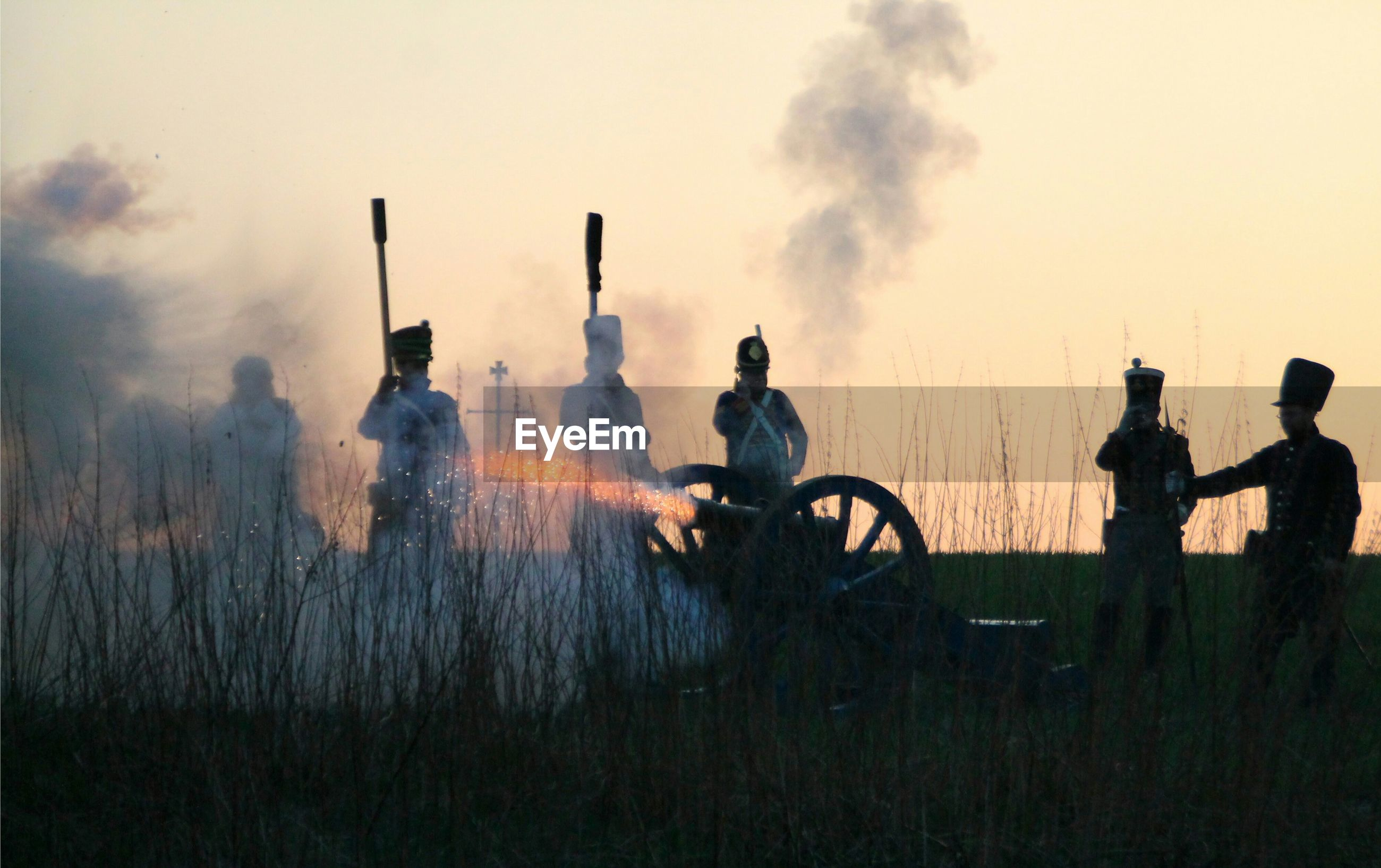 Shooting with old cannon by soldier