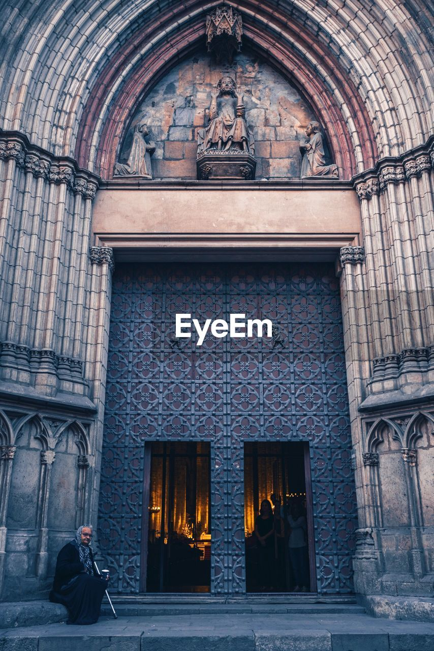 architecture, building exterior, built structure, building, entrance, men, arch, religion, full length, real people, people, window, two people, day, place of worship, rear view, door, adult