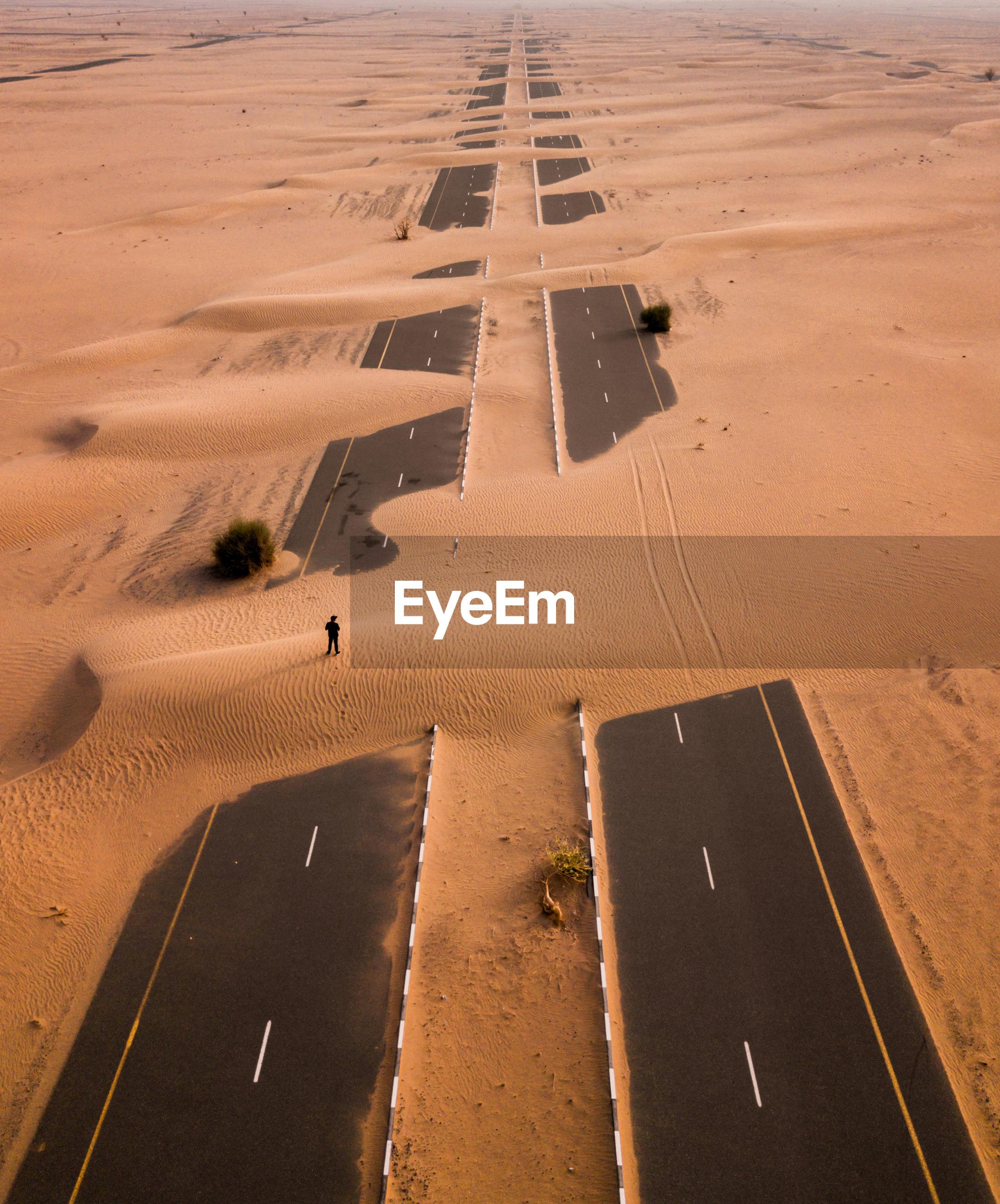 High angle view of man standing on desert