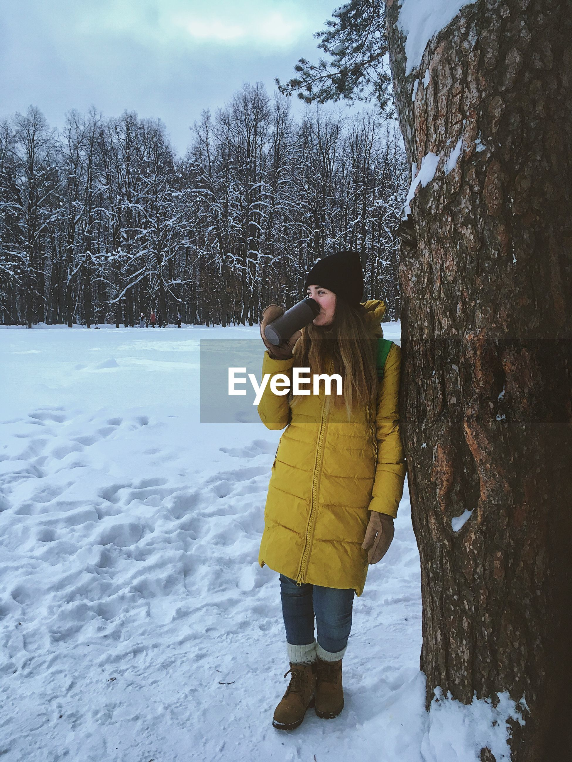 FULL LENGTH OF WOMAN ON SNOW COVERED FIELD