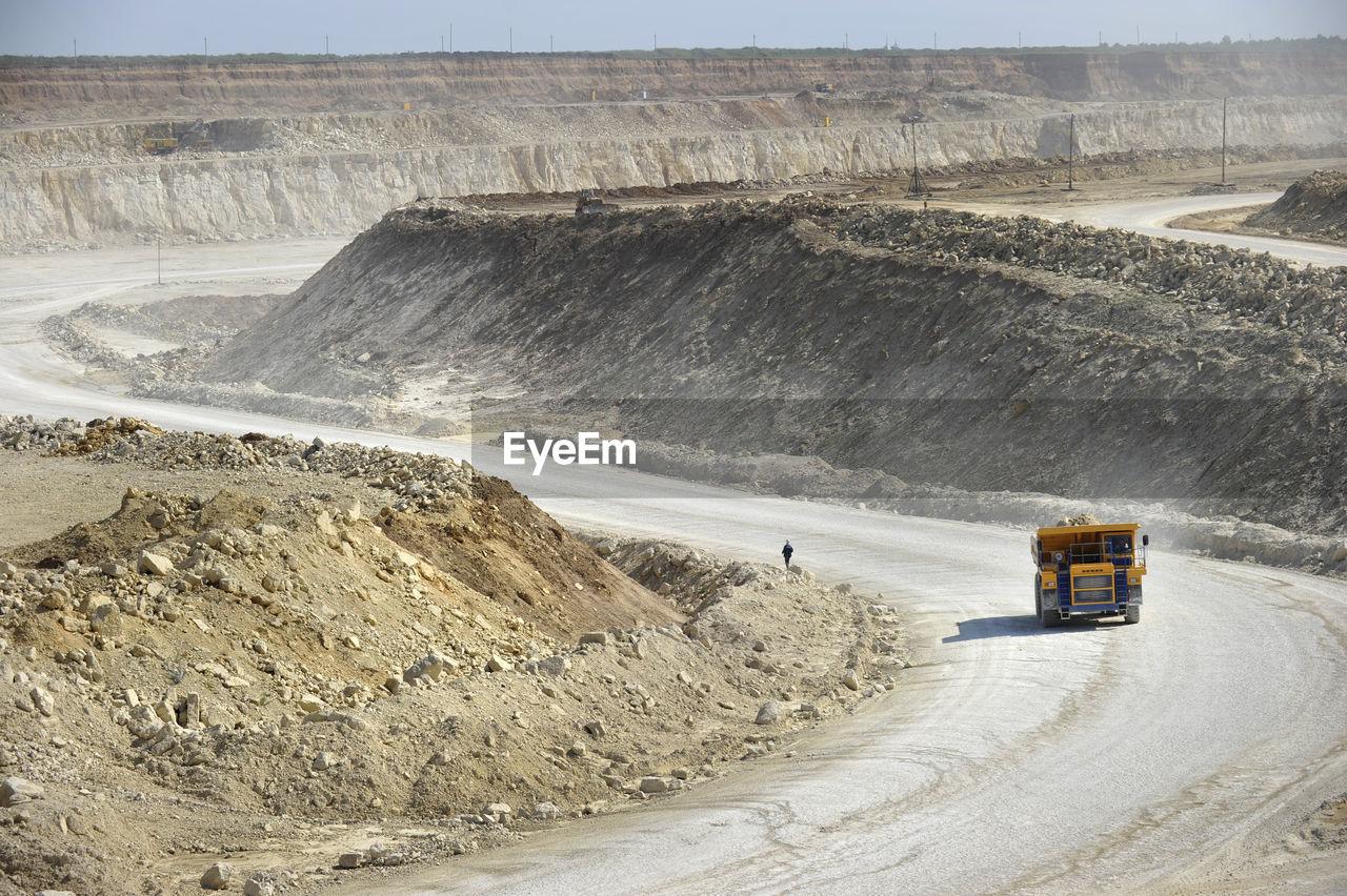 Dump Truck Moving At Quarry