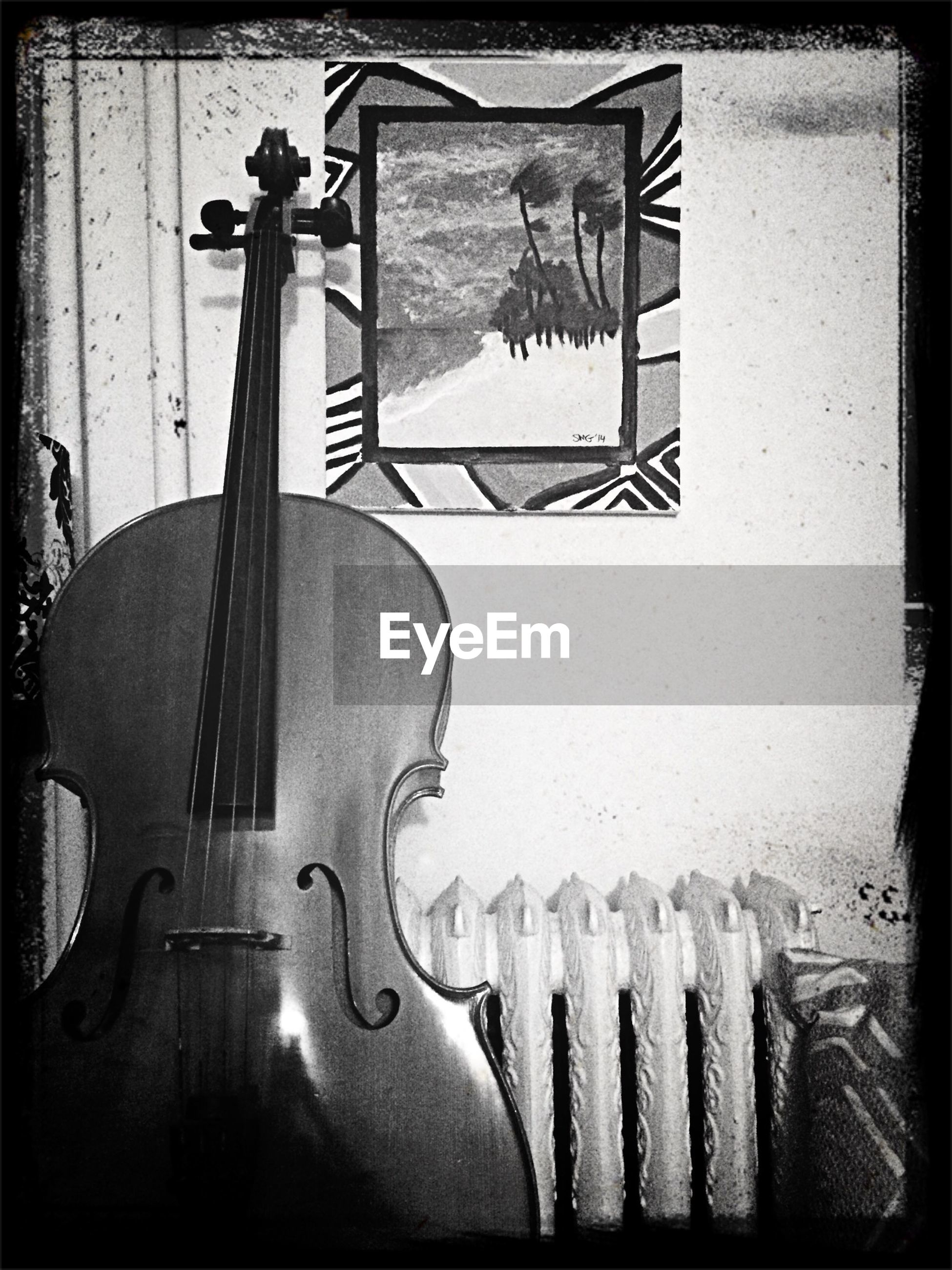 Cello against wall in house