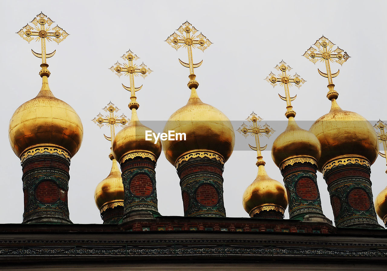 architecture, built structure, belief, religion, place of worship, no people, spirituality, gold colored, building exterior, building, low angle view, travel, travel destinations, sky, day, nature, history, side by side, the past, ornate, spire