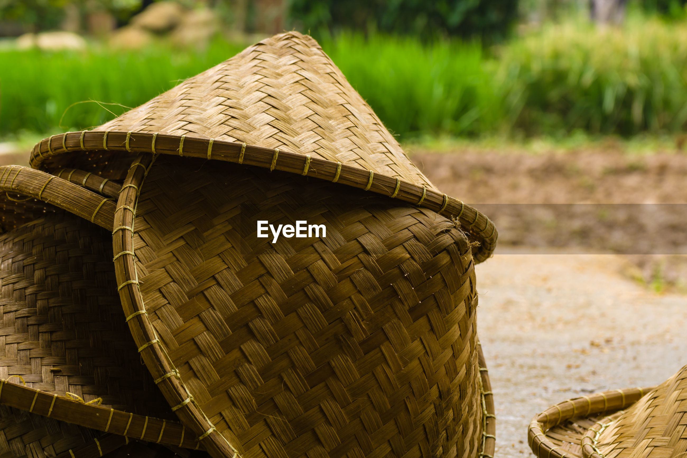 The farmers hat, made from woven bamboo when he works in the rice fields