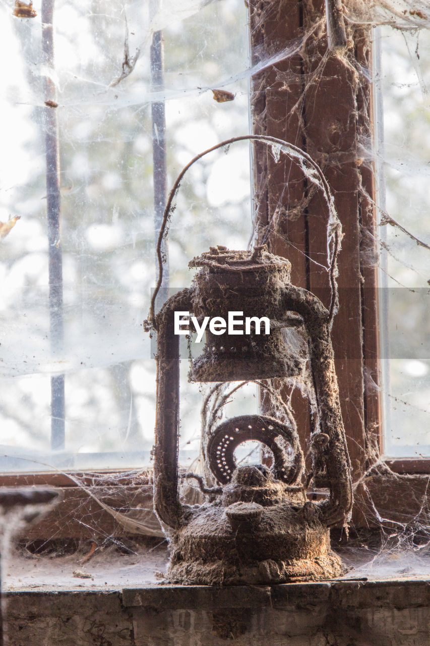 day, no people, focus on foreground, tree, rusty, metal, nature, old, outdoors, close-up, plant, tree trunk, wood - material, trunk, architecture, abandoned, branch, obsolete, weathered