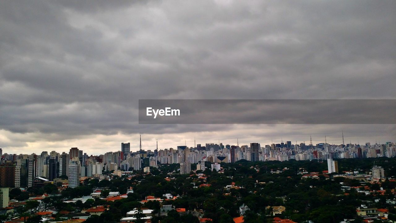 skyscraper, cityscape, city, architecture, sky, building exterior, skyline, modern, storm cloud, cloud - sky, no people, downtown, travel destinations, growth, downtown district, urban skyline, built structure, tall, outdoors, day