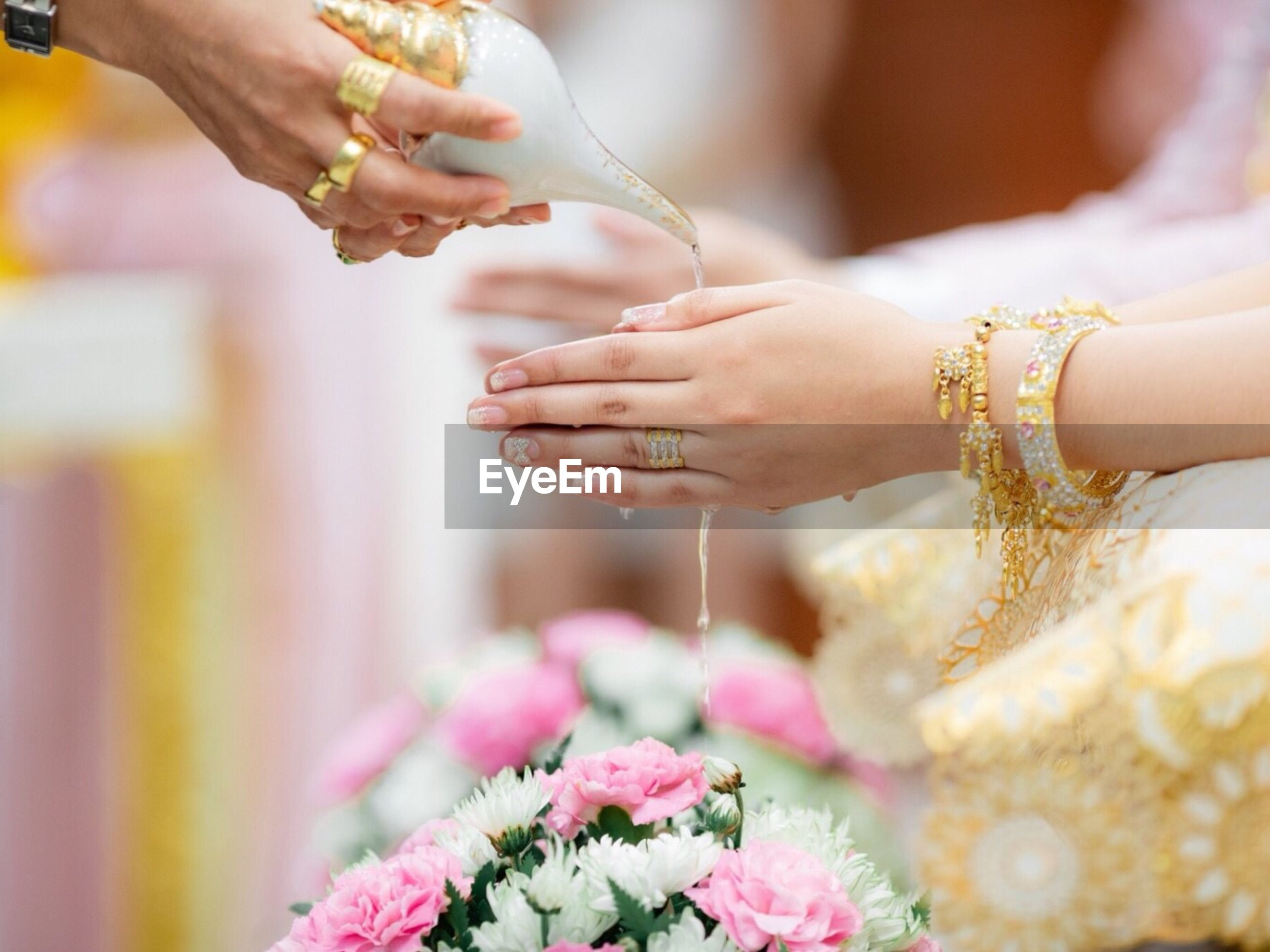 Cropped image of bride performing wedding rituals