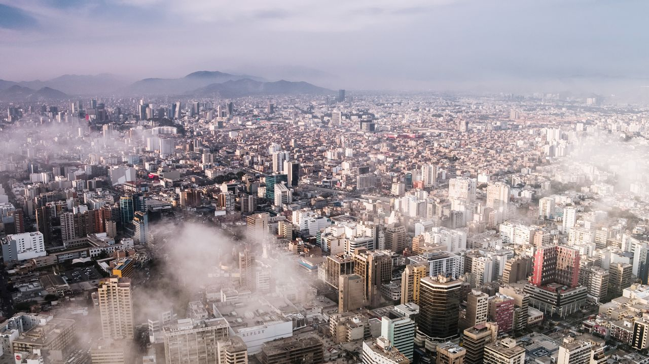 cityscape, building exterior, city, architecture, sky, built structure, building, cloud - sky, office building exterior, crowd, high angle view, nature, skyscraper, residential district, crowded, aerial view, outdoors, city life, downtown district, modern, financial district, pollution