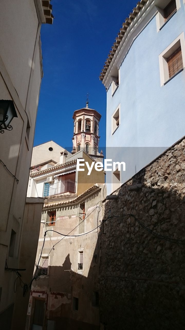 architecture, building exterior, built structure, low angle view, place of worship, religion, outdoors, no people, spirituality, day, bell tower, sky, city