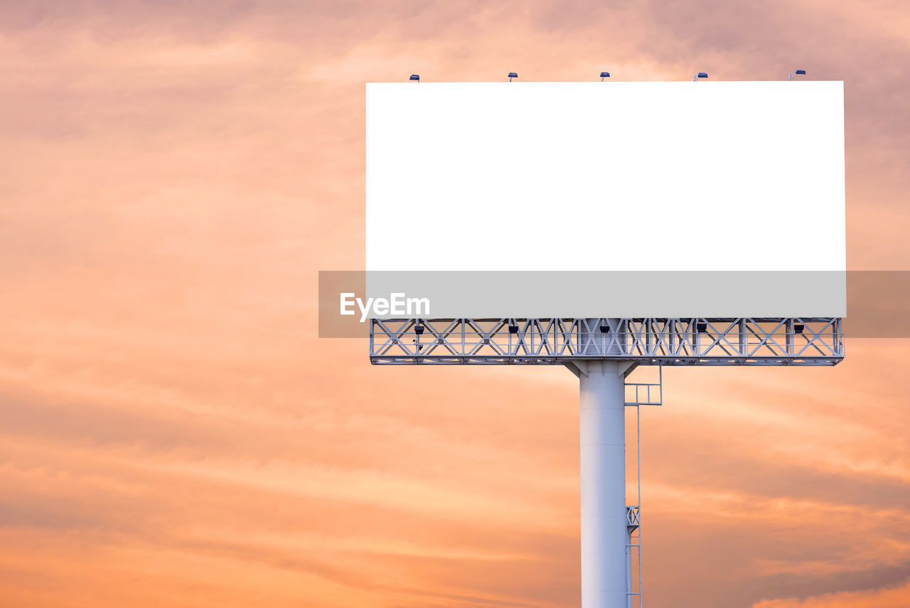 blank, copy space, no people, sky, sunset, communication, billboard, cloud - sky, sign, nature, orange color, shape, architecture, advertisement, geometric shape, outdoors, red, low angle view, lighting equipment, white color