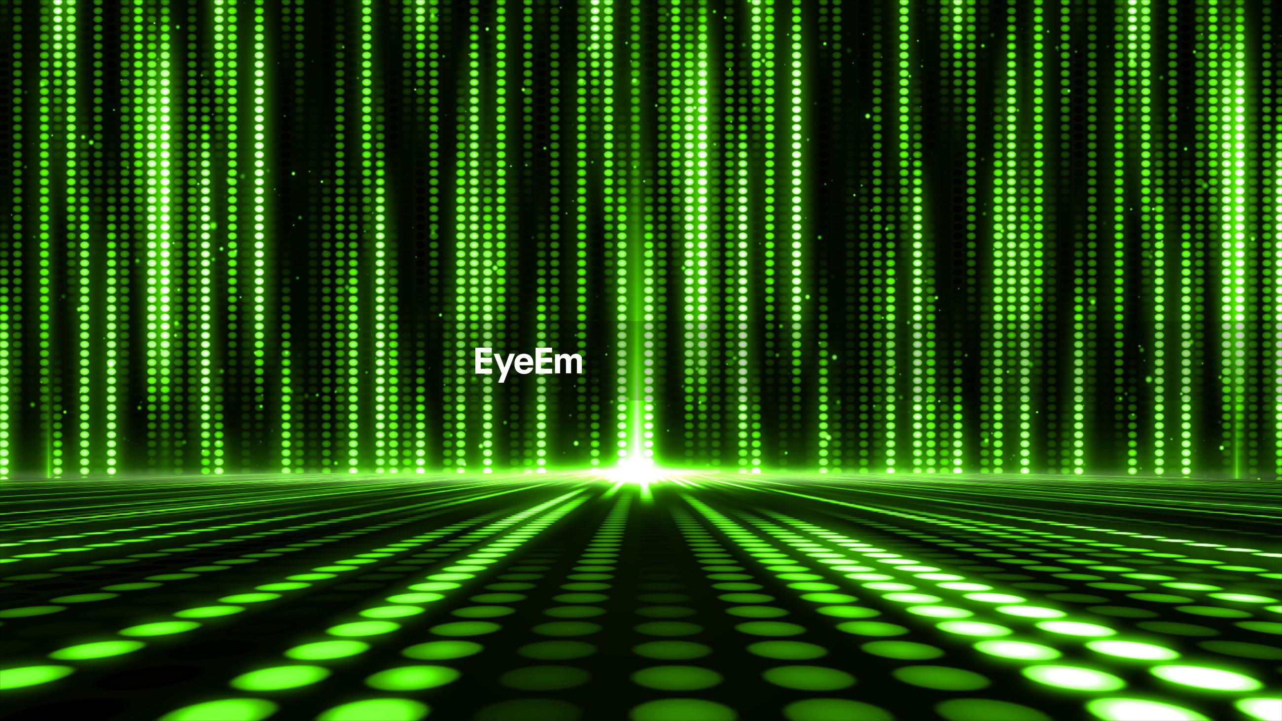 Full frame shot of illuminated green lights