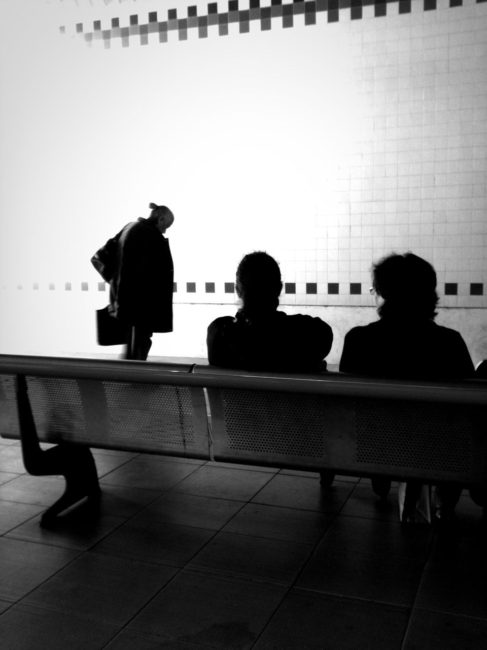 real people, sitting, men, rear view, silhouette, indoors, women, standing, lifestyles, full length, day, people
