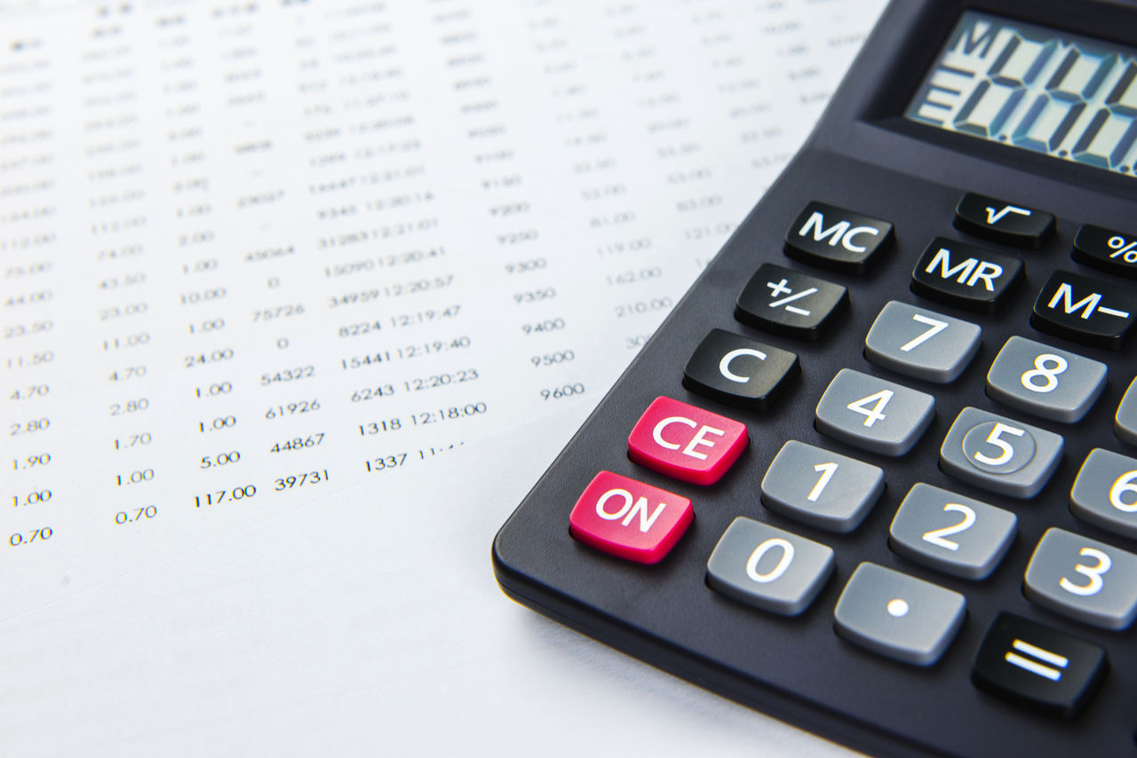 Close-up of calculator on financial papers