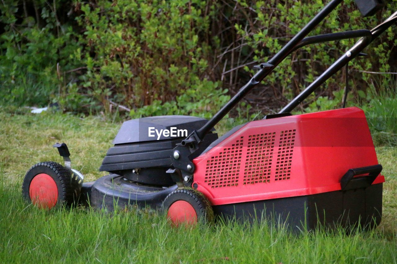 TRACTOR ON GRASSY FIELD
