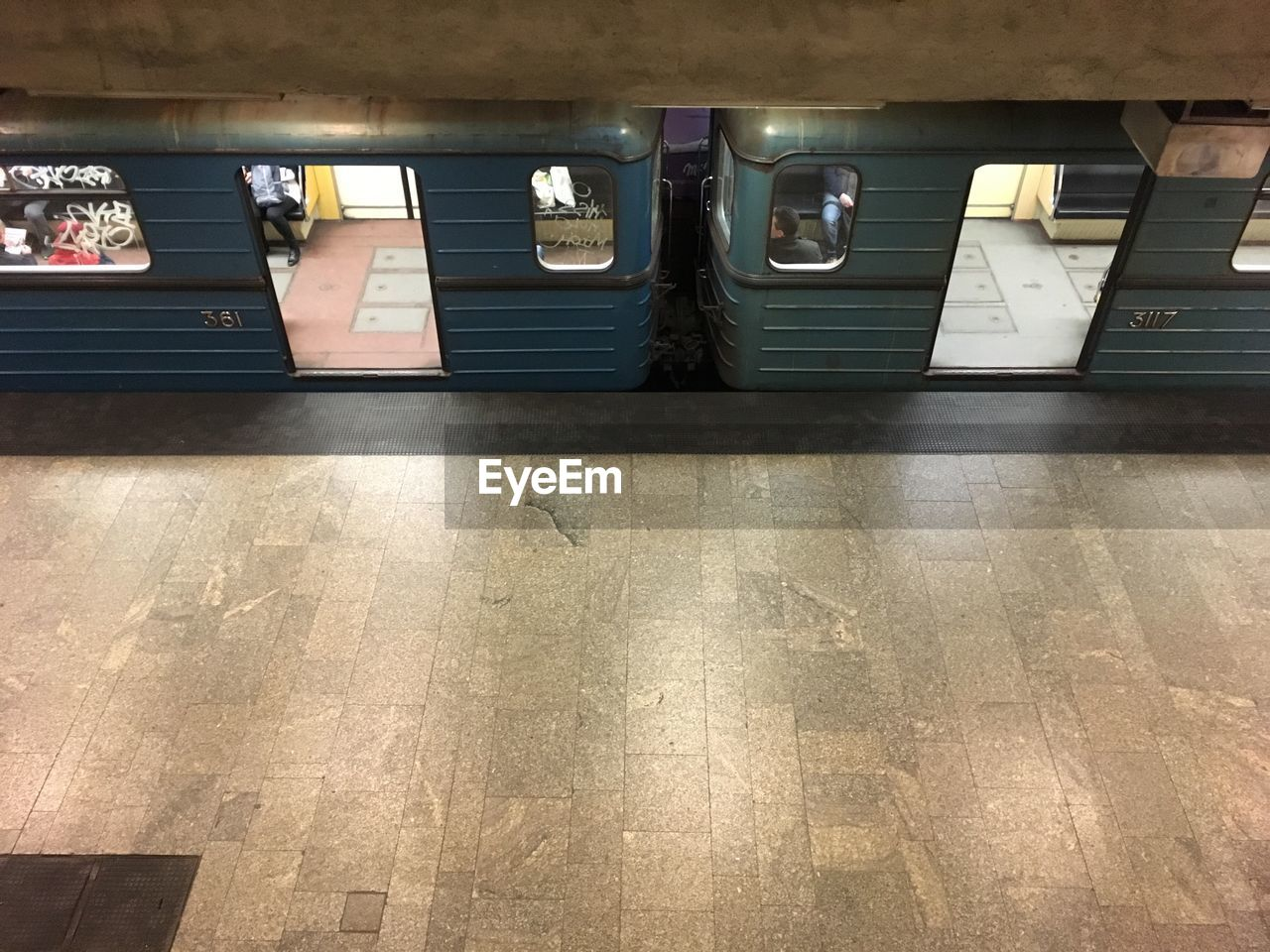 indoors, architecture, flooring, built structure, illuminated, no people, high angle view, public transportation, day, tile, lighting equipment, absence, railroad station, sunlight, rail transportation, subway, transportation, tiled floor, architectural column, ceiling