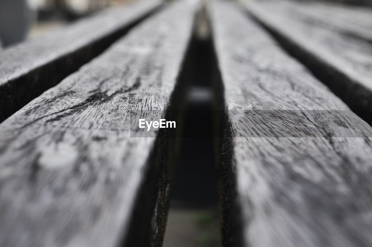selective focus, wood - material, no people, close-up, rail transportation, railroad track, day, outdoors
