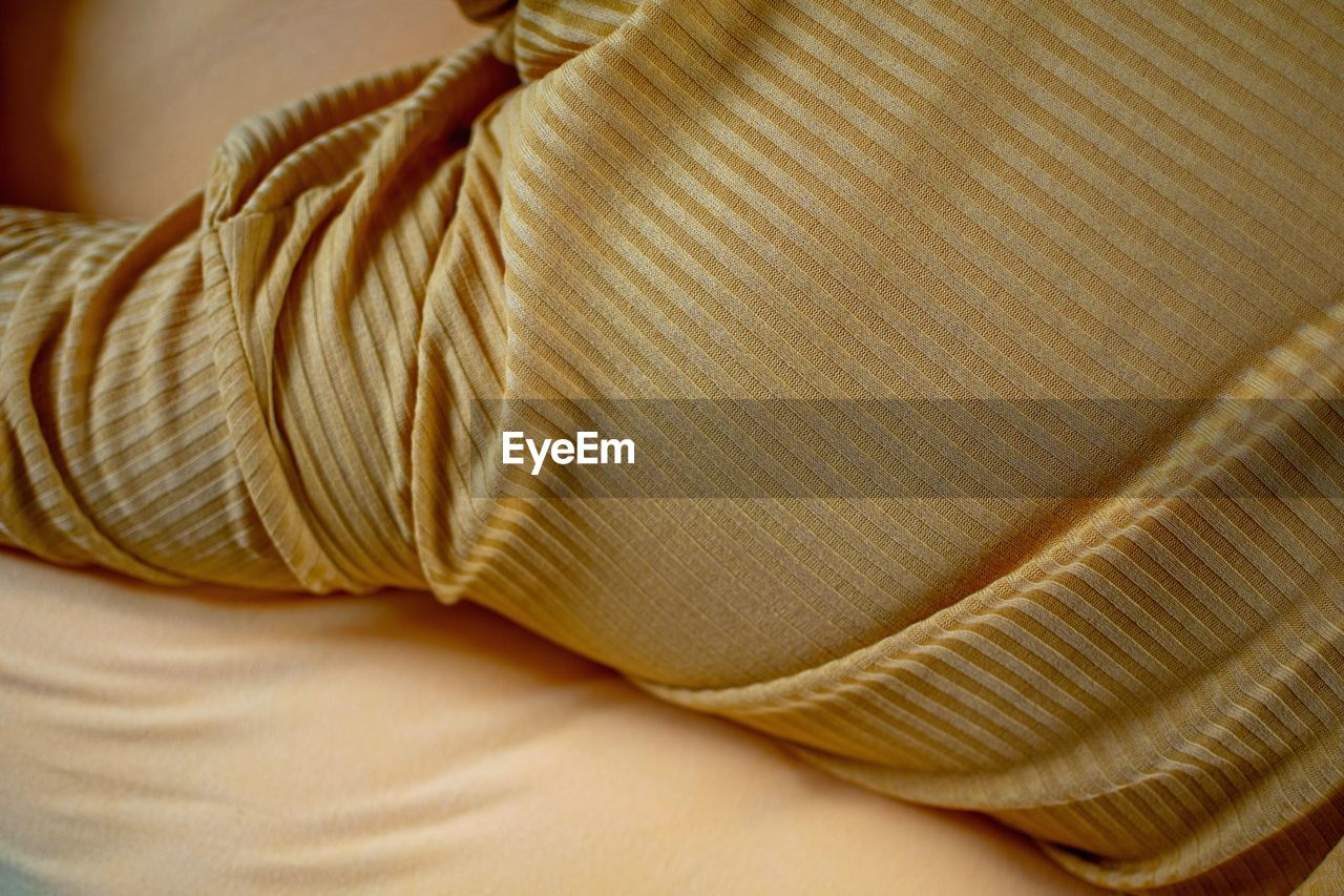 Cropped image of person on bed