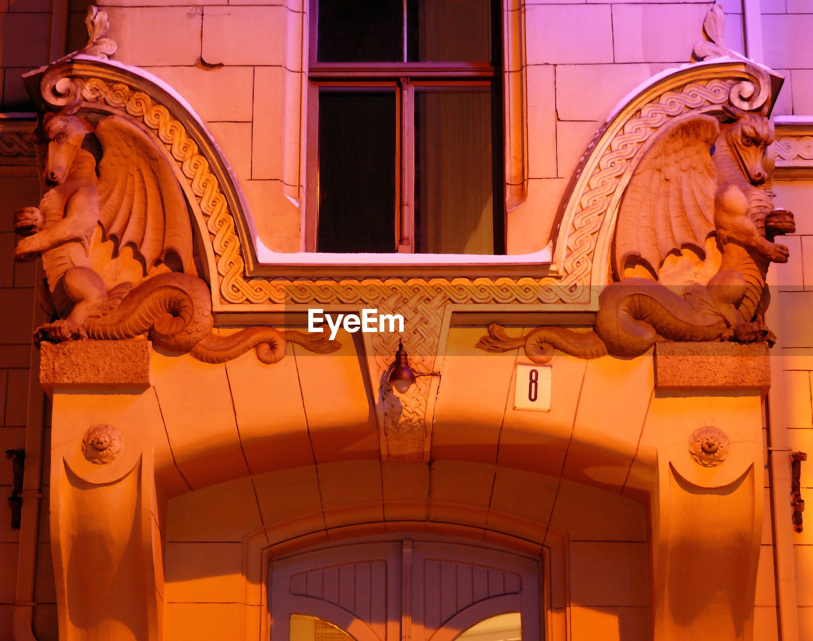 Carvings on building at night