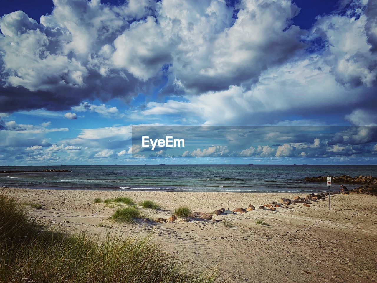 cloud - sky, sky, land, water, beauty in nature, beach, sea, scenics - nature, tranquil scene, tranquility, horizon, horizon over water, nature, sand, day, grass, plant, no people, non-urban scene, outdoors, marram grass