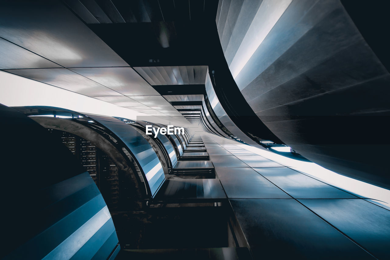 architecture, built structure, staircase, steps and staircases, indoors, modern, no people, transportation, railing, escalator, public transportation, subway, illuminated, futuristic, subway station, building, pattern, motion, convenience, ceiling