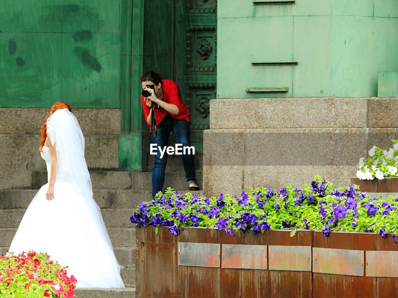 flower, real people, day, women, bride, standing, using phone, outdoors, mobile phone, wireless technology, communication, men, wedding, two people, wedding dress, photographing, lifestyles, togetherness, young women, technology, nature, bridegroom, groom, young adult, adult, people