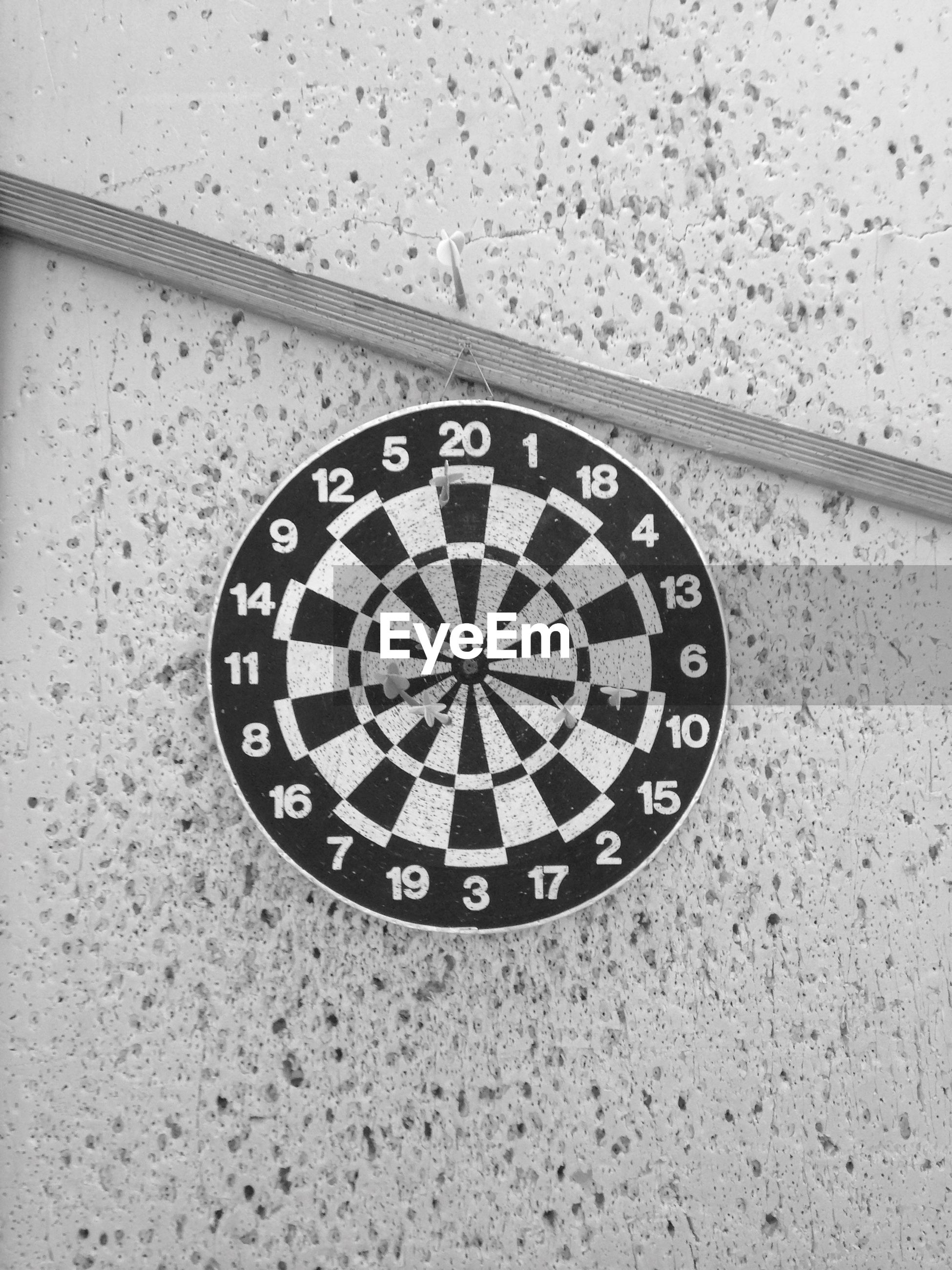 time, clock, number, circle, clock face, indoors, minute hand, close-up, geometric shape, instrument of time, wall clock, communication, text, roman numeral, single object, metal, accuracy, wall - building feature, no people, day
