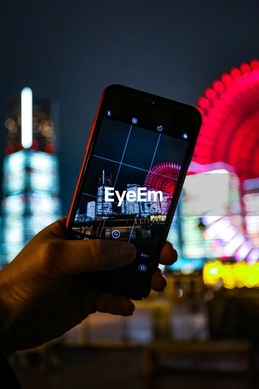 hand, human hand, communication, mobile phone, portable information device, wireless technology, smart phone, holding, focus on foreground, technology, real people, connection, illuminated, one person, night, photography themes, photographing, close-up, human body part, telephone, finger