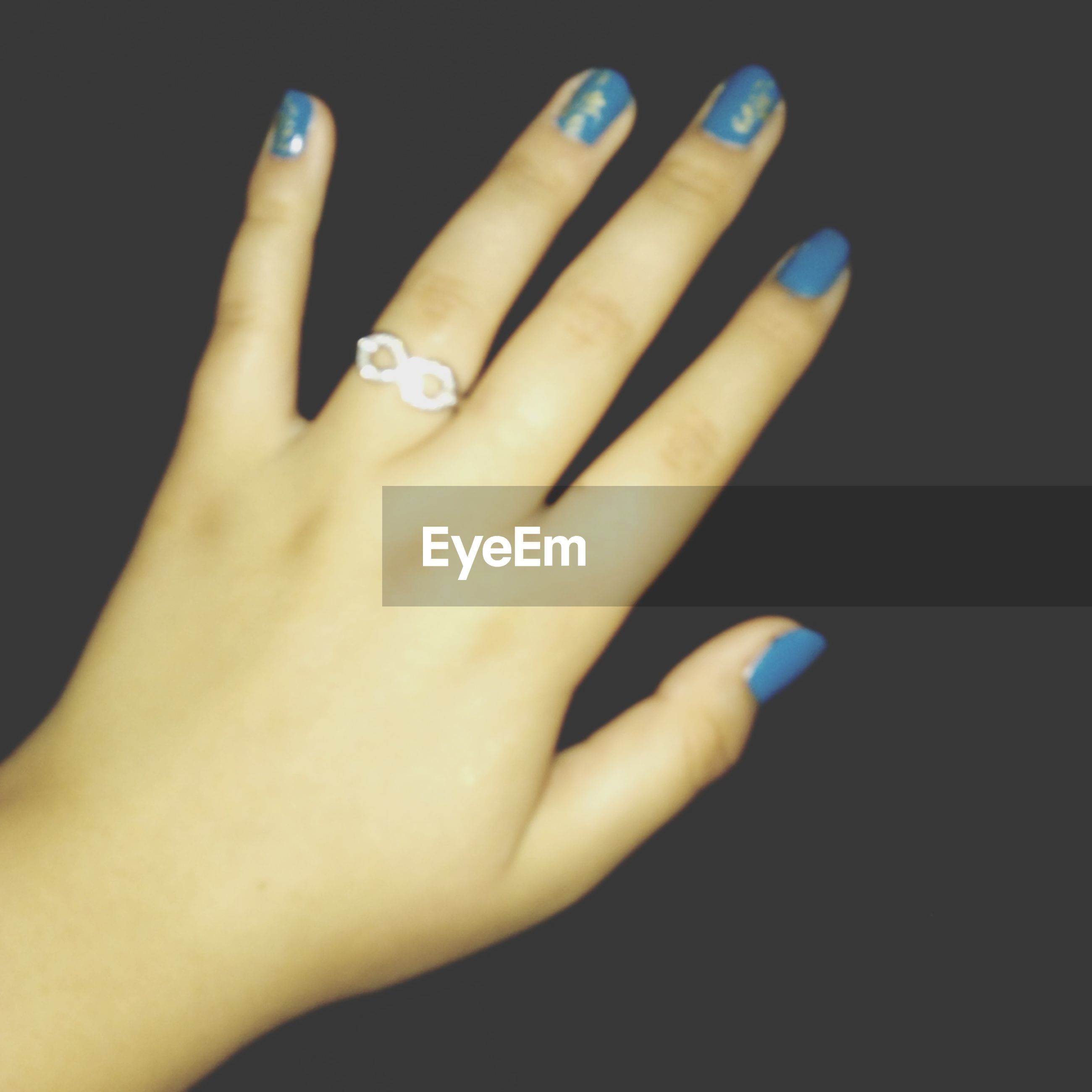 person, part of, human finger, indoors, lifestyles, close-up, holding, cropped, studio shot, nail polish, black background, leisure activity, femininity, personal perspective, ring, unrecognizable person
