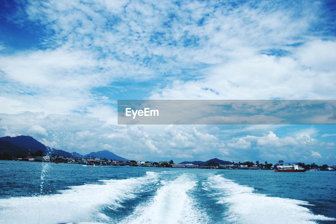 cloud - sky, water, sky, waterfront, beauty in nature, scenics - nature, mountain, nautical vessel, sea, day, nature, no people, transportation, tranquil scene, tranquility, mode of transportation, outdoors, mountain range, architecture